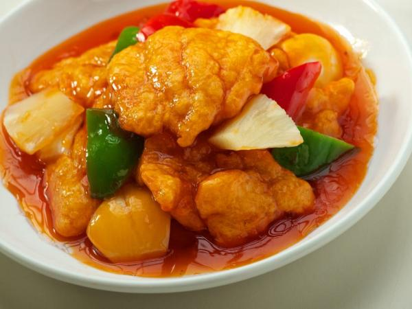 ... pineapple in a sweet and sour sauce topped on steamed jasmine rice
